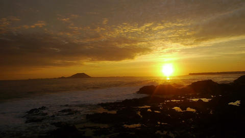 AERIAL: Golden sunset at seaside Footage