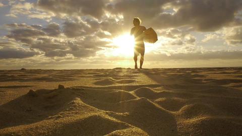 Surfer at sunrise Footage