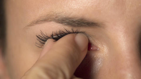 SLOW MOTION: contact lens removal Footage