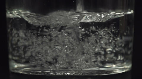 SLOW MOTION: Pouring glass of water Footage