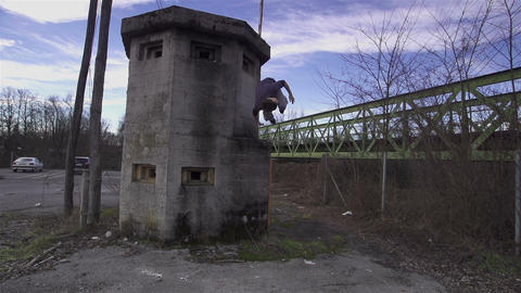 SLOW MOTION: Free runner does side flip Footage