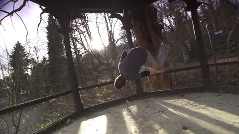SLOW MOTION: Free runner does a side flip Footage