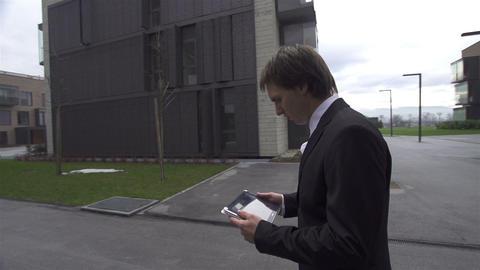 Businessman gets bad news over digital tablet Live Action
