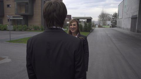 Businessman and businesswoman handshake Footage