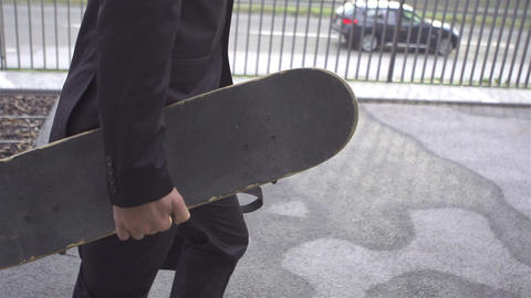 Businessman With Skateboard stock footage