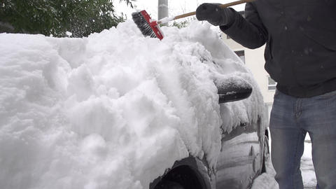 SLOW MOTION: Removing snow from a car Live Action