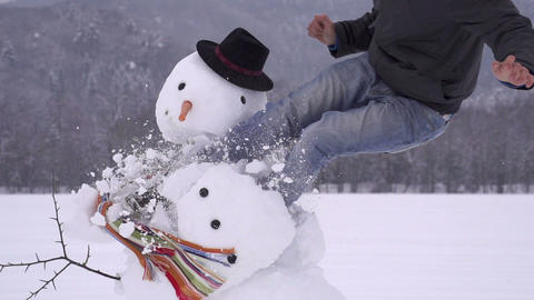 Man destroying a snowman Footage
