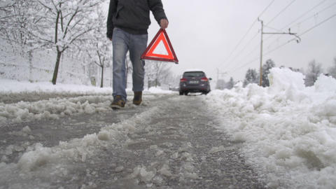 Man placing warning triangle on the road Footage