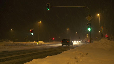 Busy crossroad in blizzard Footage
