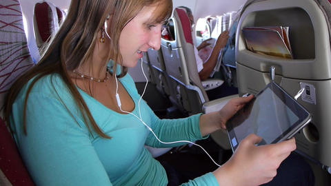 Young woman playing video games on digital tablet  ビデオ