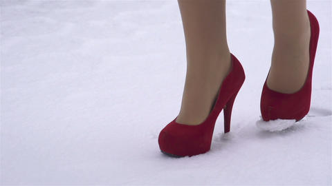 SLOW MOTION: Woman In High Heels Walking In The Sn stock footage