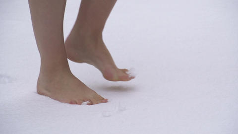 SLOW MOTION: barefoot in the snow Footage