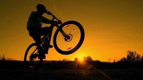 SLOW MOTION: mountain biker riding wheelie Footage