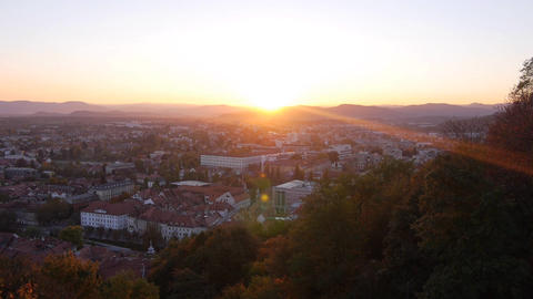 AERIAL: Rising Up Over European City At Sunset stock footage