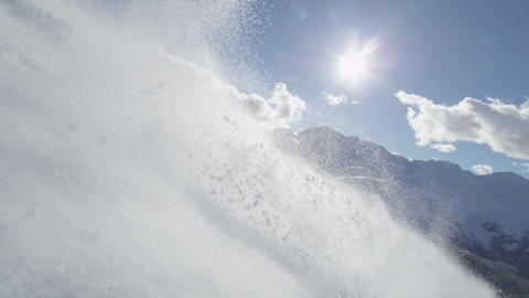 SLOW MOTION: Snowboarder speeding pass the camera Footage