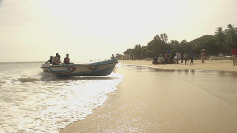 A boat landing on the beach Footage