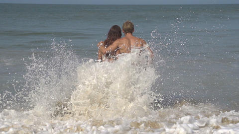 SLOW MOTION: Romantic young couple on a beach Stock Video Footage
