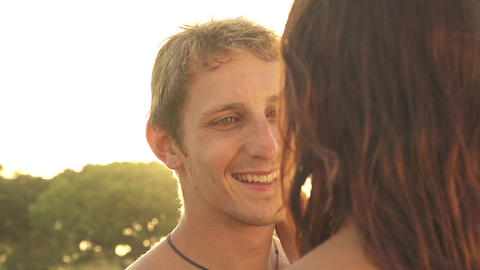 SLOW MOTION: Happy young couple in love at sunset Footage