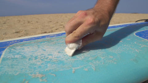 CLOSE UP: Applying wax on a surf Footage