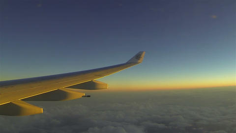 Traveling by plane in sunset Live Action