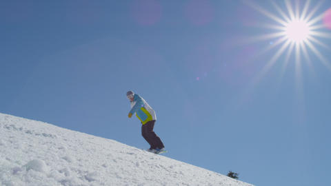 SLOW MOTION: Snowborder sprays fresh snow into the Footage