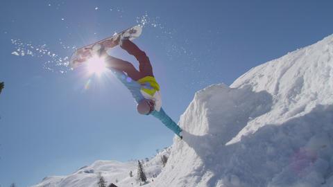 SLOW MOTION: Snowboarder does handplant trick Footage