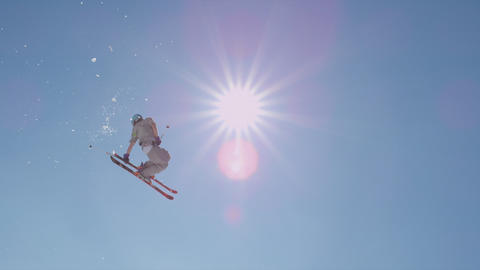 SLOW MOTION: Freestyle skier jumping a kicker Footage