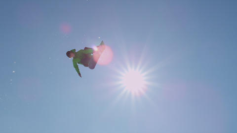 SLOW MOTION: Snowboarder does a trick over a kicke Footage