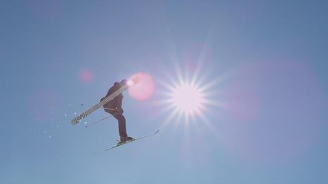 SLOW MOTION: Freestyle skier jumping big air Footage