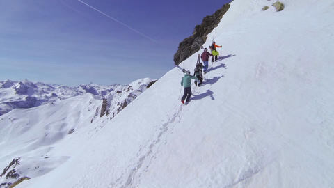 AERIAL: Skiers walking uphill Footage