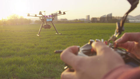 SLOW MOTION: Drone Operator Flying Multicopter Out stock footage