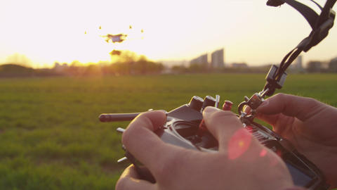 SLOW MOTION CLOSEUP: Multicopter Operator Flying A stock footage
