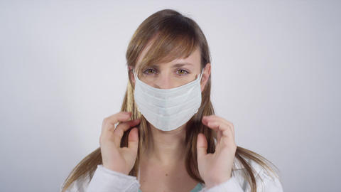 Young doctor putting on surgical mask Footage
