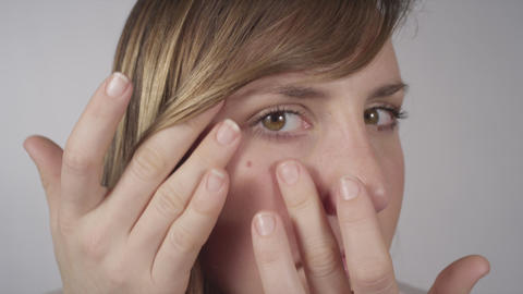 Young Woman Checking Her Skin stock footage