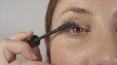CLOSE UP: Applying mascara on eyelashes Footage