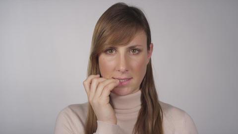 Nervous woman biting her fingernails Footage