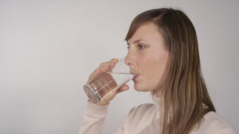 Young Woman Drinking Water stock footage