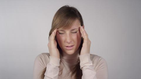 Female having a headache Footage
