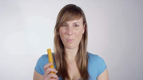 Young healthy woman eating a carrot Footage