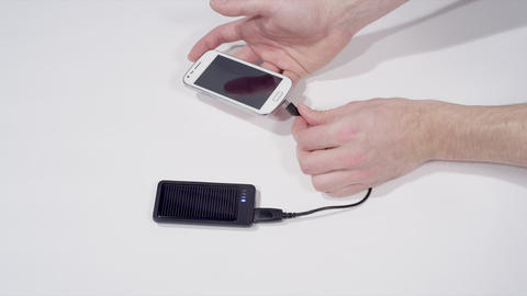 Charging smartphone with solar cell phone charger Stock Video Footage