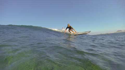 CLOSE UP: Surfing with a longboard Footage