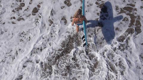 AERIAL: Ocean waves hitting rocks on the shore Footage