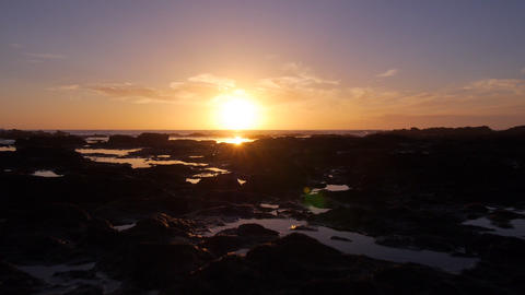 AERIAL: Beautiful sunset on rocky shore Footage
