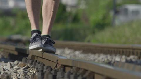 SLOW MOTION: Walking On Railroad Track On Hot Summ stock footage