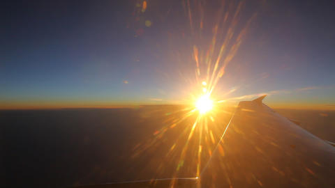 Sunset seen through the window of jet airplane FUL Footage