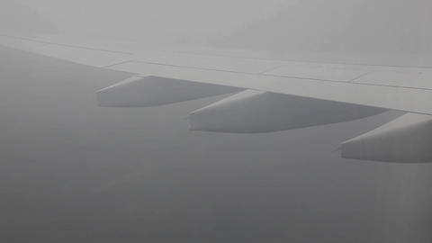 Clouds and fog seen through the window of jet airp Footage