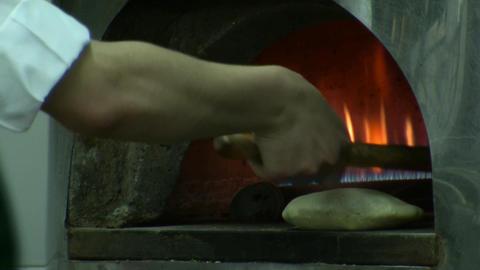 Baking Pita bread in brick oven Footage