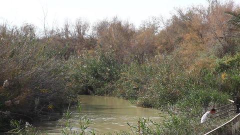 Pilgrims baptise in the Jordan River Holy Land Isr Footage