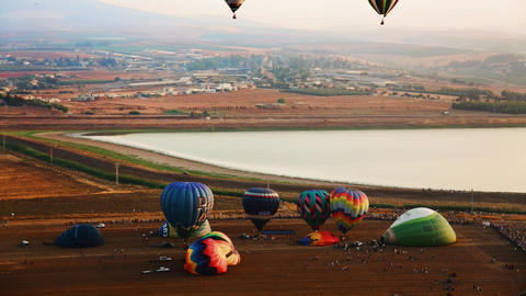 Hot air balloons take off at sunrise aerial timela Footage