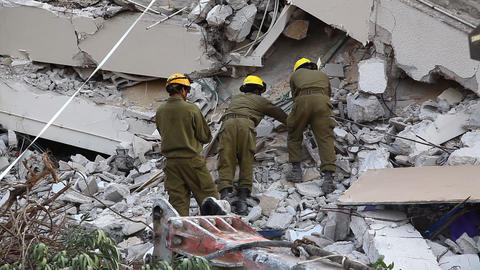 Soldiers search for earthquake casualties digging Footage